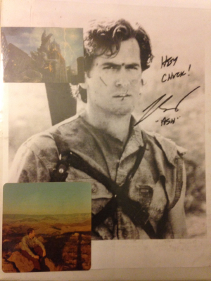 The front of the binder: the printed out photo of Bruce Campbell, the cutout of '98 Godzilla, and the picture of my father.